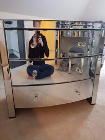 Mirrored glass chest of drawers, 4 drawers. Crack on bottom drawer.