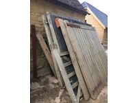 Selection of pairs of large barn doors, and selection of timber framed windows.