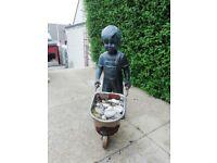 Garden statue (boy with wheelbarrow)