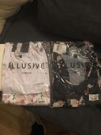 Two illusive london vests white and black