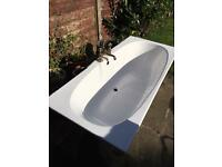 Bath tub and taps