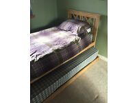 Attractive single wooden bed with pull out guest bed option