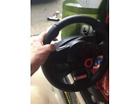 playstation steering wheel and pedals.