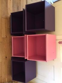 Storage boxes in purple and pink