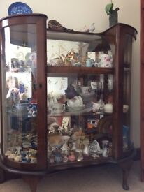 1950s Glass fronted China display cabinet, curved glass doors and top with wood surround.
