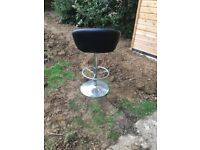 Two black kitchen/dining stool chairs