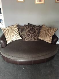 Large brown leather and fabric sofa and large cuddle chair