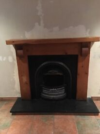 Solid wood fire place with cast iron inset