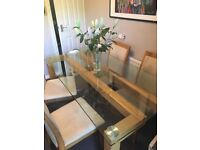 Reid Glass Table and 4 Cream Fabric Chairs