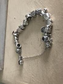 Genuine pandora bracelet full of charms