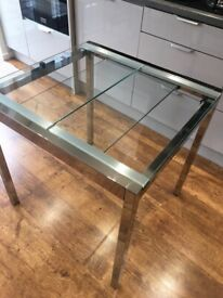 Glass topped table with chrome coloured frame