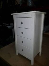 A brand new small white finish 4 draeer chest.