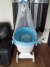 A lovely crib moses basket on wheels