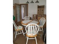 Extending kitchen table with white tile top, pedestal base and four chairs