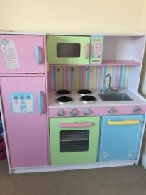 Children's pink play kitchen