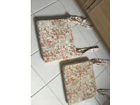 Pair of fabric floral pattern tie on chair cushions