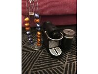Nespresso pixie coffee machine, milk frother and capsule holder