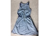 Size 8 M and S Denim skater style dress with waist and pocket features and seamed upper bodice