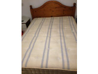 Pine frame double bed with quality sprung mattress available from 27th March