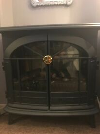 Heater with false log burner effect