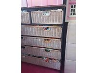 Pink painted drawers with metal frames