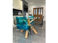 Solid oak table with glass top and 4 chairs