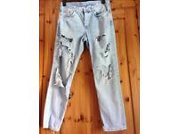 Ripped light denim jeans