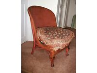 Wicker chair. Lloyd Loom style with metal sprung seat.