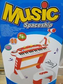 Kids toy musical piano and stool brand new