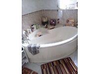 Cream bathroom suite for sale, corner bath, sink with pedestal and toilet
