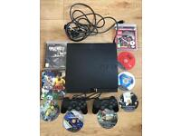 PS3 with 2 pads and 9 games