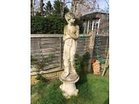 Fabulous large stone sculpture of a lady standing on a separate column