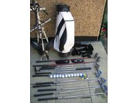 Set of left handed golf clubs & woods,trolley, bag, & accessories