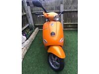 Orange Vespa 50cc
