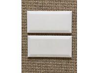 8.5 square metres of white metro tiles
