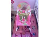 Infant to toddler rocking seat with calming vibrations