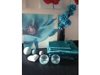 Teal bedroom accessories with bed cover and curtains