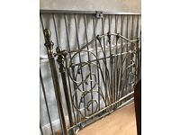 Gold/bronze colour bedstead , double size