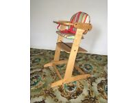 High chair wood and vinyl adapts into normal safe seat when child is bigger