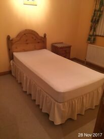 Single divan bed with pine headbed and mattress