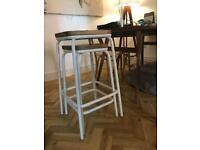2 x different size wooden stools