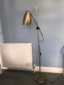 Adjustable Gold shaded floor standing lamp