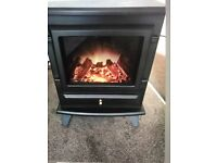 New Adam Hudson electric stove and flu pipe
