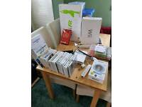 Nintendo Wii with Wii fit and multiple games, bits and bobs