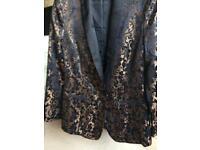 Ladies kaleidoscope black and gold tuxedo jacket. Never worn size 12