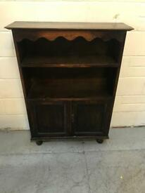 Vintage solid Oak Bookcase standing on bun feet.
