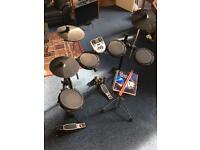 Alesis DM7X Electric Drum-Kit with Stool, Drumsticks and learning book