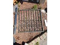 Wrought iron garden gate with post