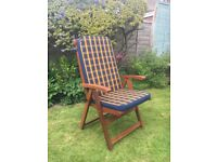 Excellent condition. 4 x wooden garden chairs with cushions. 1 blue parasol .