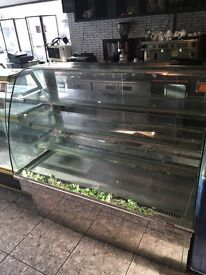 a coolspan pattasie/food display cabinet with four selves. good condition